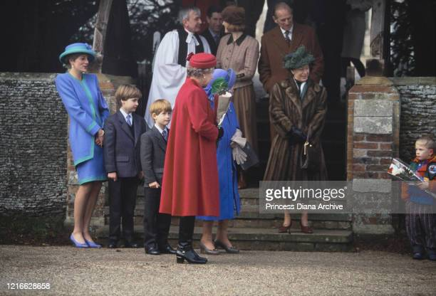 British royals Diana, Princess of Wales , wearing a blue and turquoise suit by Catherine Walker, with a matching hat, Prince William, Prince Harry,...