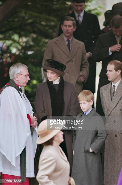 British Royals Diana, Princess of Wales , wearing a brown coat with black trim and a matching winter hat, Prince Charles, Prince Harry, and Prince...