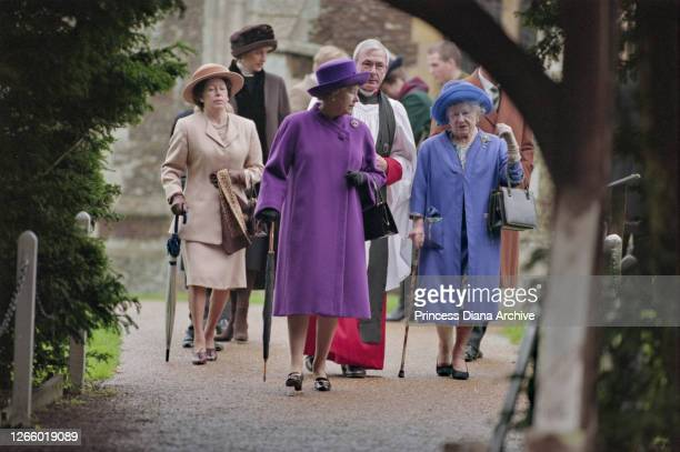 British Royals Diana, Princess of Wales , wearing a brown coat with black trim and a matching winter hat, Princess Margaret , Queen Elizabeth II and...