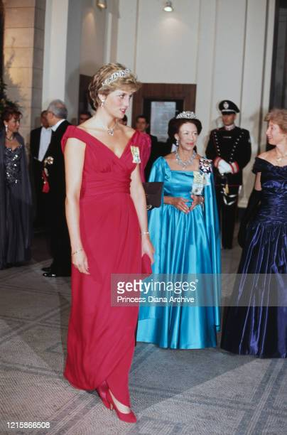 British royals Diana, Princess of Wales , wearing a Victor Edelstein dress, and Princess Margaret attending a banquet held in honour of Italian...