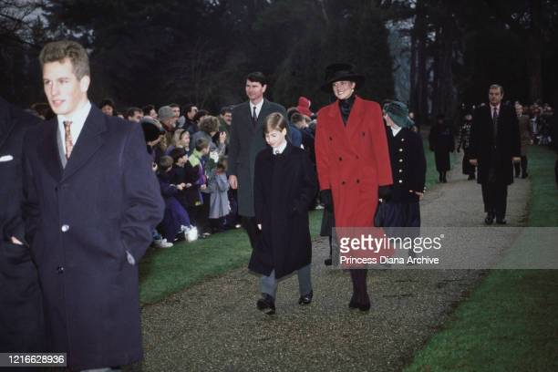 British royals Peter Phillips, Prince William, and Diana, Princess of Wales , wearing a red coat with a black hat, attend the Christmas Day church...