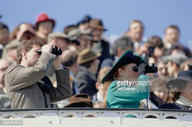 British Royals Prince Andrew, Duke of York and his wife Sarah, Duchess of York, wearing a green suit and a black hat with green trim, attend the...