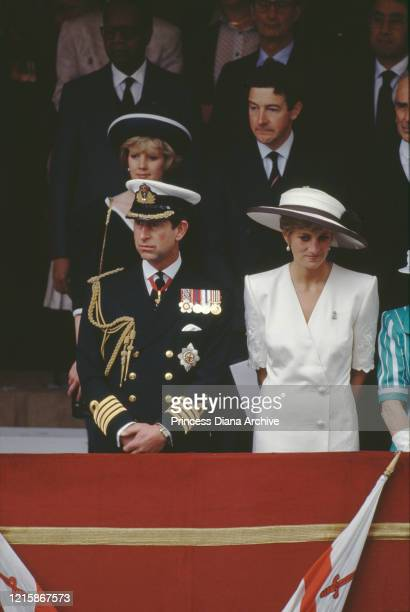 British royals Prince Charles dressed in full naval uniform, and Diana, Princess of Wales , wearing a hat designed by Marina Killery, attend the Gulf...