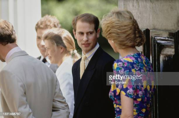 British Royals Prince Edward and Diana, Princess of Wales , wearing a blue floral print dress, on the occasion of the Queen Mother's 89th birthday,...