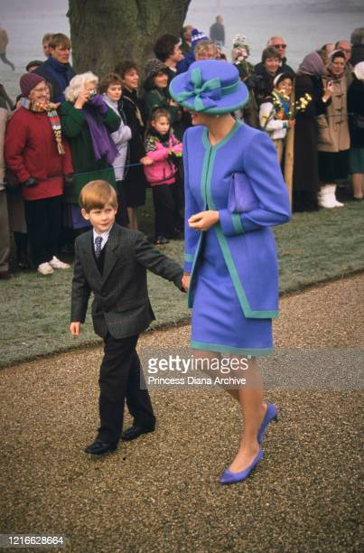 British royals Prince Harry and his mother Diana, Princess of Wales , wearing a blue and turquoise suit by Catherine Walker, with a matching hat,...