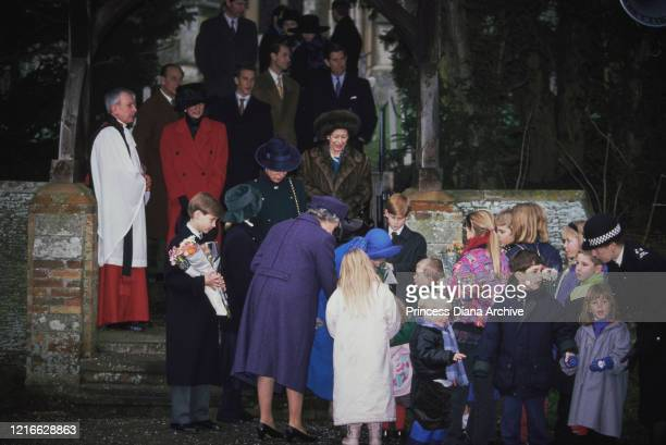 British royals Prince Philip, Duke of Edinburgh, Diana, Princess of Wales , wearing a red coat with a black hat, Peter Phillips, Prince William,...