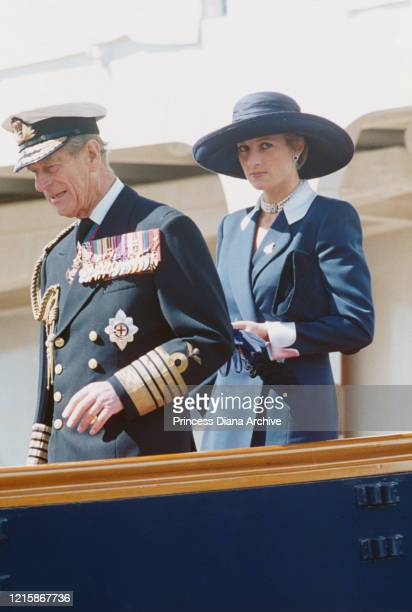 British royals Prince Philip, Duke of Edinburgh, dressed in full naval uniform, and Diana, Princess of Wales , wearing a dark green outfit with a...