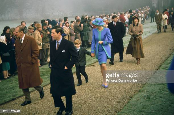 British royals Prince Philip Duke of Edinburgh Prince Charles Prince Harry Diana Princess of Wales wearing a blue and turquoise suit by Catherine...