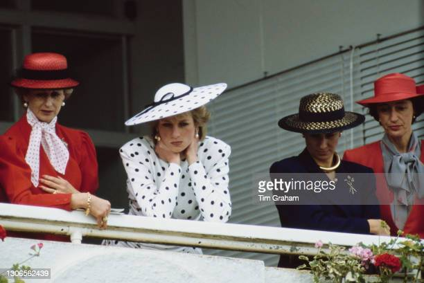 British Royals Princess Alexandra, Diana, Princess of Wales , wearing a dress by Victor Edelstein and hat by Frederick Fox, an unspecified woman, and...