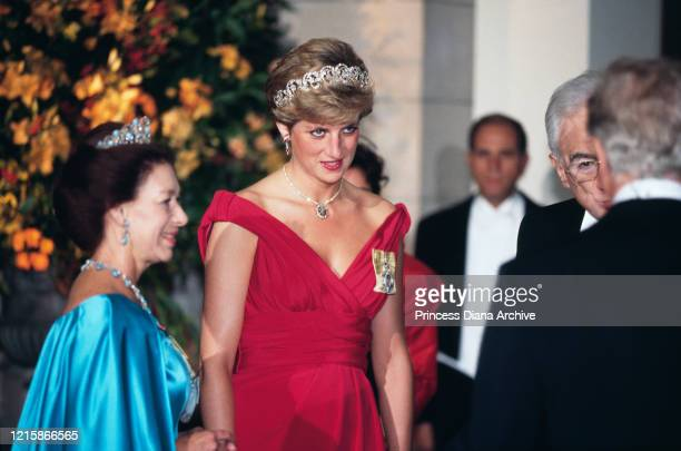 British royals Princess Margaret and Diana, Princess of Wales , wearing a Victor Edelstein dress, attending a banquet held in honour of Italian...