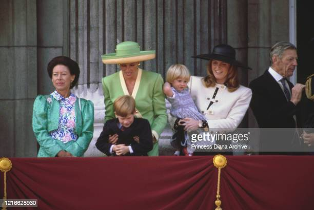 British royals Princess Margaret Countess of Snowdon Diana Princess of Wales wearing a green and yellow outfit with matching hat with Prince Harry...