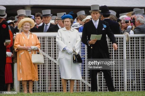 British Royals Queen Elizabeth The Queen Mother , Queen Elizabeth II and the Queen's racing manager Henry Herbert, 7th Earl of Carnarvon on Derby Day...