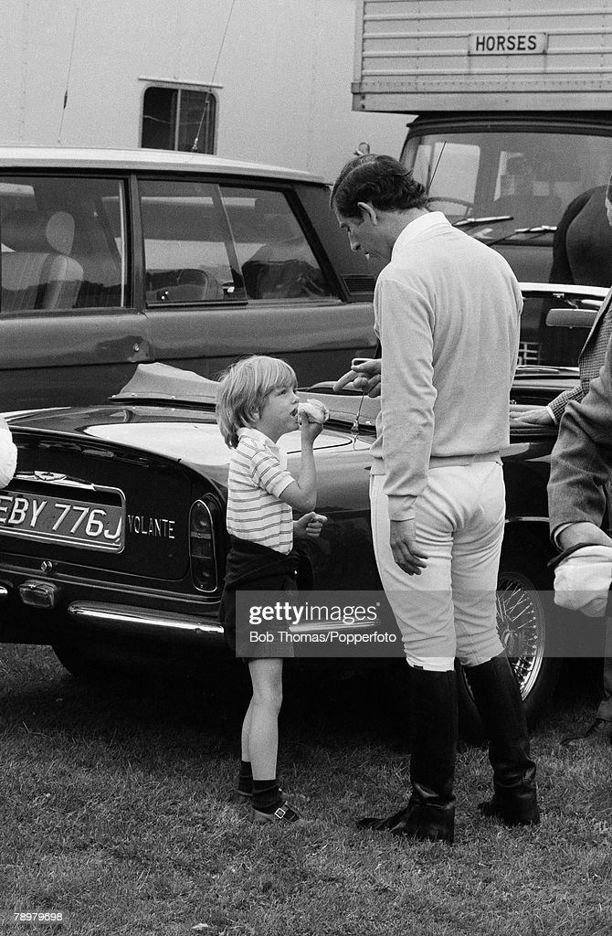 British Royalty. Ascot, England. Charity Showjumping Event. May 1981. Prince Charles talks to a young Tom Parker Bowles, son of Camilla Parker Bowls and his godson. : News Photo