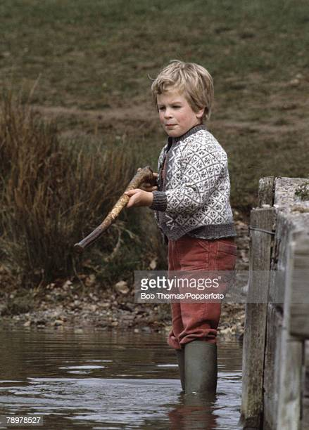 British Royalty, Badminton Horse Trials, England Master Peter Phillips, son of Princess Anne and Captain Mark Phillips, playing with a stick in the...