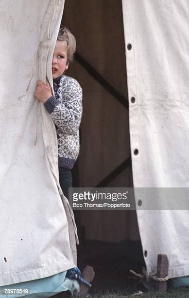 British Royalty, Badminton Horse Trials, England Master Peter Phillips, son of Princess Anne and Captain Mark Phillips, peeps through the opening of...
