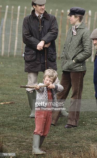 British Royalty, Badminton Horse Trials, England Princess Anne with her son Peter Phillips playing with a stick