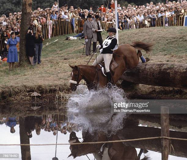 British Royalty Burghley Horse Trials England Princess Anne riding her horse 'Stevie B' jumping the water fence called the 'Trout Hatchery'