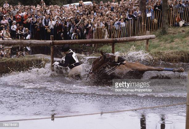 British Royalty Burghley Horse Trials England Princess Anne riding her horse 'Stevie B' falls at the water fence called the 'Trout Hatchery'
