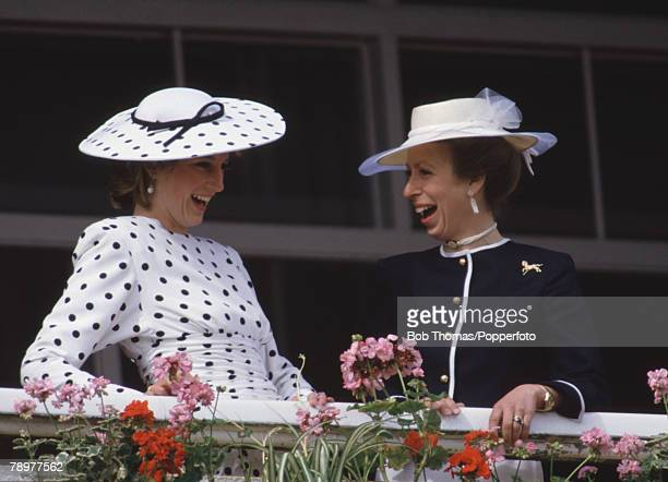 British Royalty, Horse Racing, Epsom Derby, England 1986, Princess Diana and princess Anne enjoy a funny moment from the Royal box