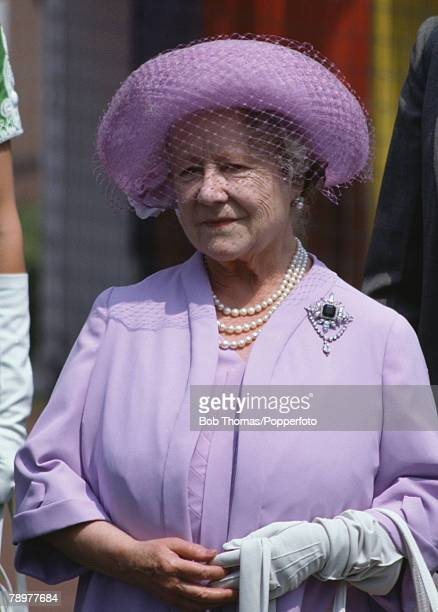 British Royalty Horse Racing Epsom Derby England June 1982 The Queen Mother wearing a purple coat and hat attending the racing
