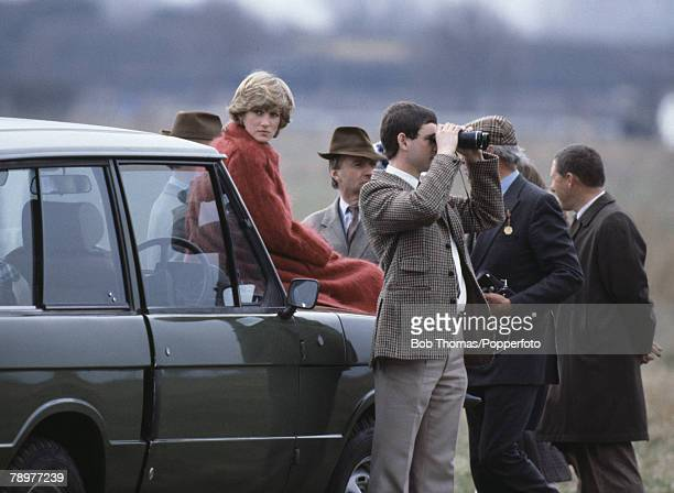 British Royalty Horse Racing Grand National Princess Diana sits on the bonnet of a Range Rover