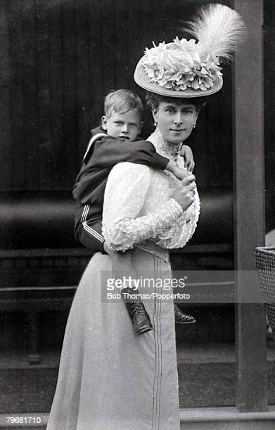 British Royalty, H,R,H,The Princess of Wales, with her son Prince George on her shoulders, pic: circa 1906