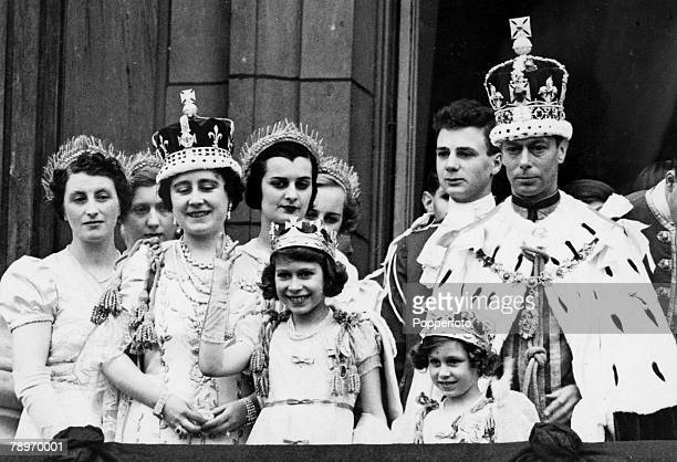 British Royalty, London, England, 12th May 1937, King George VI and Queen Elizabeth pictured wearing their crowns and coronation robes as they stand...