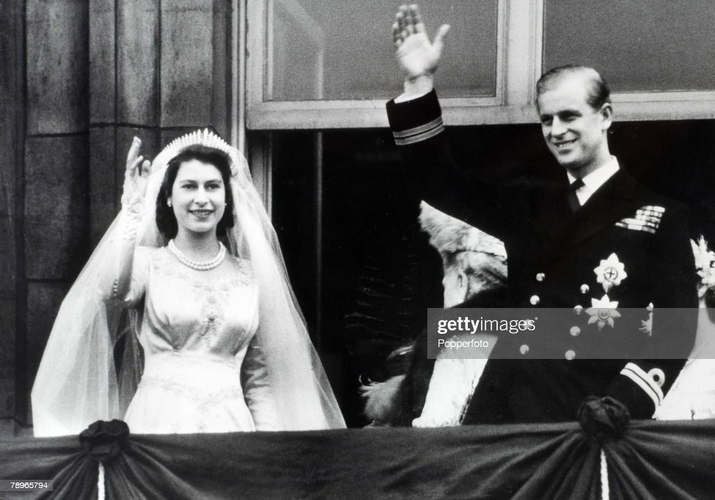 British Royalty. London, England. 20th November 1947. Princess Elizabeth (now The Queen) and Prince Philip, The Duke of Edinburgh wave to crowds from the balcony of Buckingham Palace following their marriage. : News Photo