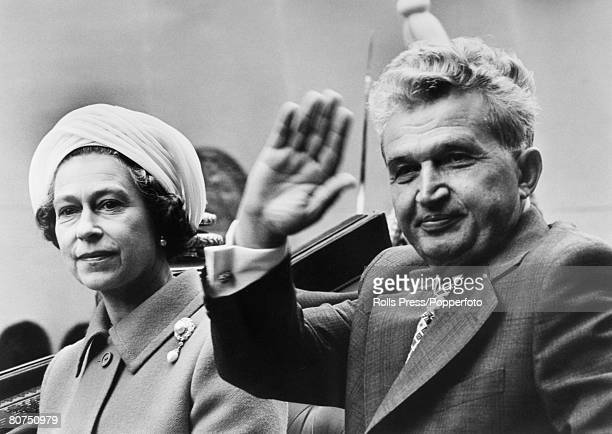 British Royalty London England HRH Queen Elizabeth II with Romanian President Nicolae Ceausescu as they travel across London in the State Coach...