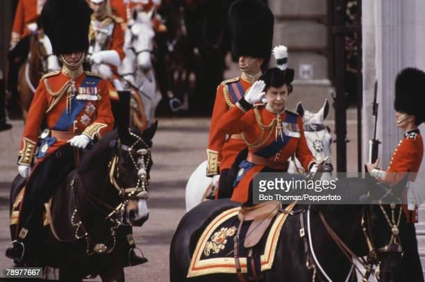 British Royalty London England June1981 Queen Elizabeth II on horse leaving Buckingham Palace during the Trooping of the Colour ceremony