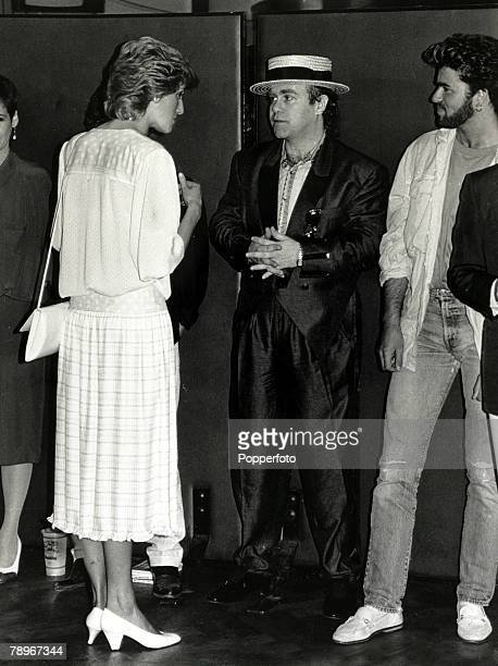 "British Royalty, Music, pic: 13th July 1985, Diana, Princess of Wales pictured chatting to musicians Elton John and George Michael at the ""Feed the..."