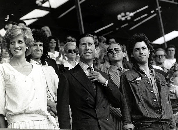 "British Royalty. pic: 13th July 1985. The Prince and Princess of Wales with Bob Geldof at the ""Feed the World"" Live Aid concert at Wembley Stadium."