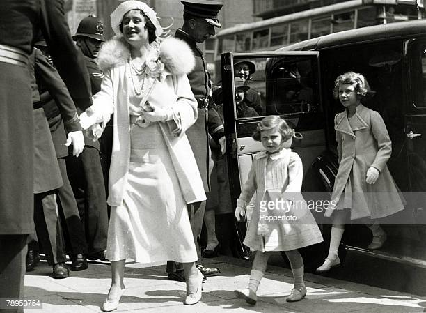 16th May 1935, HRH,The Duchess of York with her children Princess Margaret and Princess Elizabeth, right, as they arrive at the Royal Tournament at...