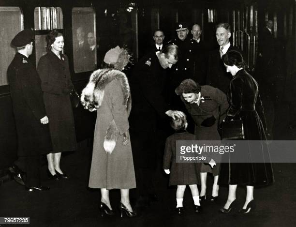 17th November 1951 Princess Elizabeth and The Duke of Edinburgh greet their son Prince Charles as they are pictured at Euston Station on the last leg...
