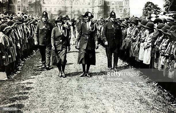 The Duchess of York, left, arriving to inspect the Hertfordshire Girl Guides at Hatfield Park, The Duchess of York, born Lady Elizabeth Bowes-Lyon,...