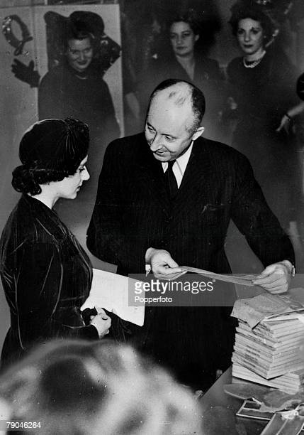1950's HRHPrincess Margaret pictured with Christian Dior at his famous Paris fashion house where he is showing his fashion house's nylon stockings