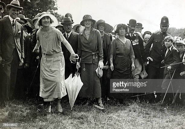 20th July 1923 HRH Duchess of York tries her hand at the coconut shy sideshow during a visit to Loughton Essex The Duchess of York was to become...