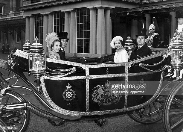 21st November 1972 London HM Queen Elizabeth with the Duke of Edinburgh Prince Charles and Princess Anne in an open carriage leaving Buckingham...
