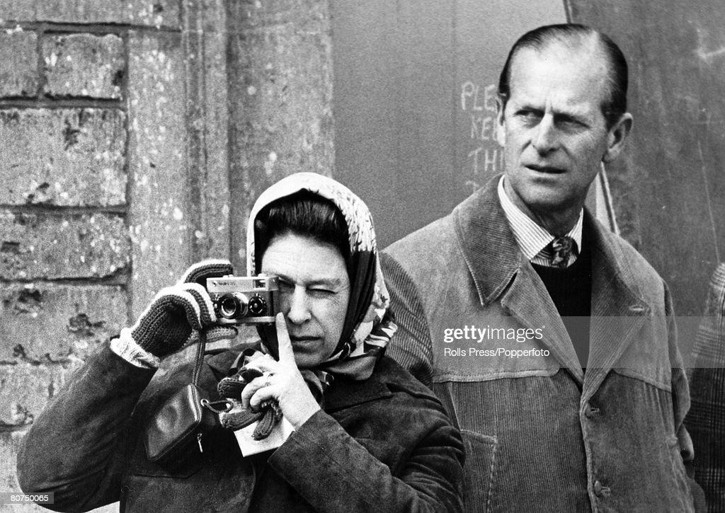 British Royalty pic: 27th April 1974. Badminton, Gloucestershire. HM. Queen Elizabeth using her camera alongside the Duke of Edinburgh at the Badminton Horse Trials. : News Photo