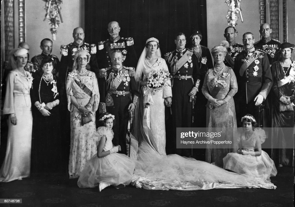 British Royalty pic: 1934. The wedding of HRH.The Duke of Kent to HRH. The Princess Marina of Greece, pictured here at Buckingham Palace, the couple flanked by King George V and Queen Mary and the family. : News Photo