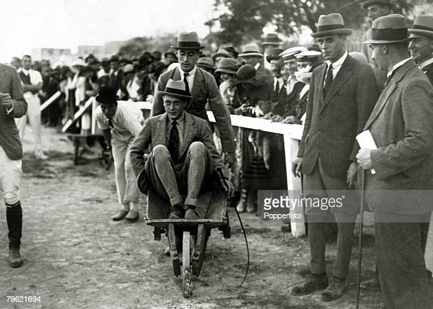 8th November 1921 HRHEdward Prince of Wales pictured in Malta riding in a wheelbarrow being pushed by Lord Louis Mountbatten at a polo gymkhana The...