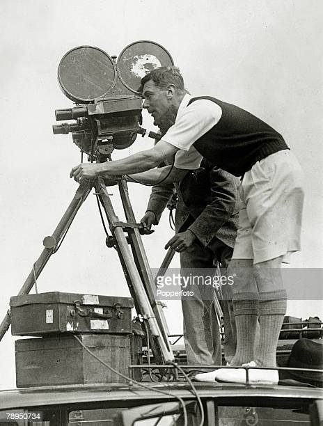 August 1935 HRHThe Duke of York pictured taking pictures with a cinematograph during his visit to a boys camp at Southwold Suffolk for public...