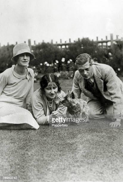 Circa 1930, HRH,The Duchess of York with a friend, left and HRH, Edward, Prince of Wales and Cairn terrier, The Duchess of York, born Lady Elizabeth...