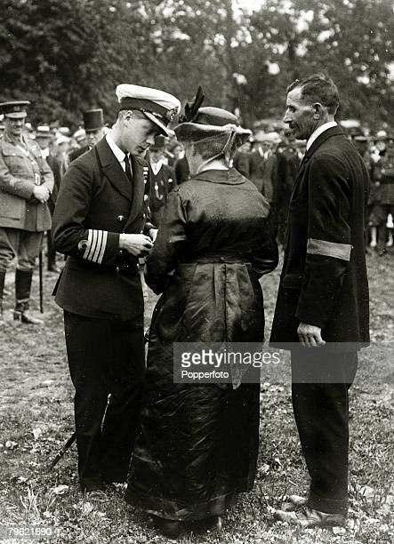 November 1919 HRHEdward Prince of Wales pictured at Halifax Nova Scotia Canada presenting the DCM to the parents of a Canadian soldier who fell at...