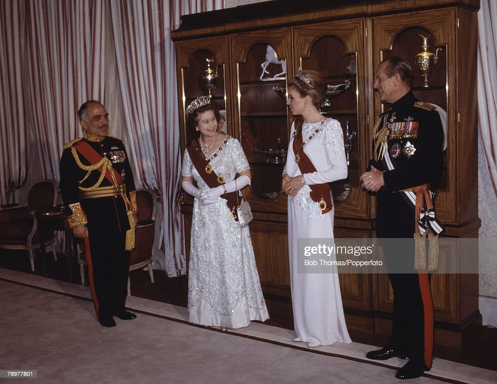 British Royalty. Royal Tour to Jordan. 26th March 1984. Amman. Queen Elizabeth II, wearing formal dress and jewellry and diamond Tiara while attending an official State banquet at the start of her tour to the country. With her are Prince Philip, King Huss : News Photo