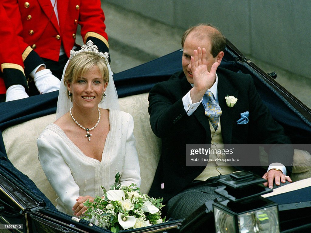 British Royalty. Royal Wedding. Windsor, London, England. June 1999. Prince Edward and his wife Sophie ride in an open top carriage. : News Photo