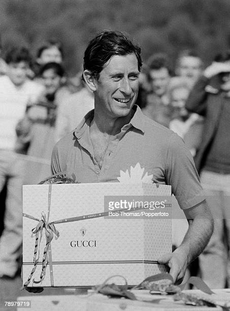 British Royalty Smith's Lawn Windsor England Prince Charles holding his polo prize by Gucci