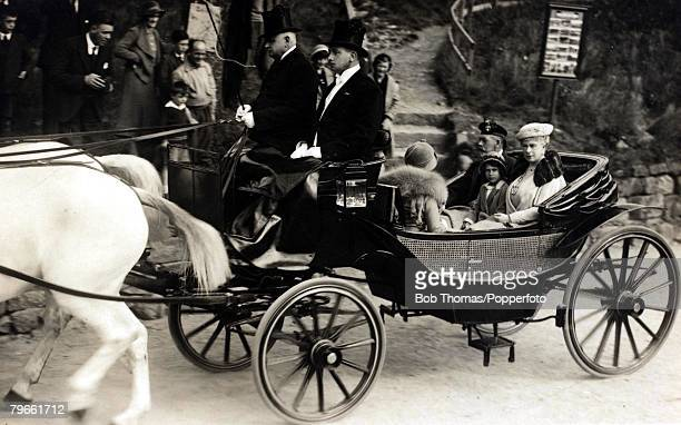 British Royalty The Royal party go by carraige to Crathie Church Scotland seen in the rear seat of the carriage are King George V of Great...