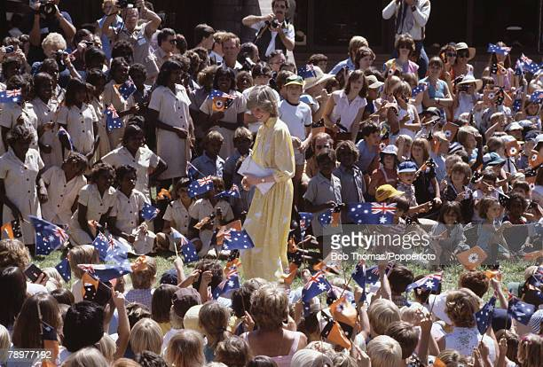 British Royalty Tour of Australia 21st March 1983 Princess Diana surrounded by school children waving Australian flags while visiting Alice Springs
