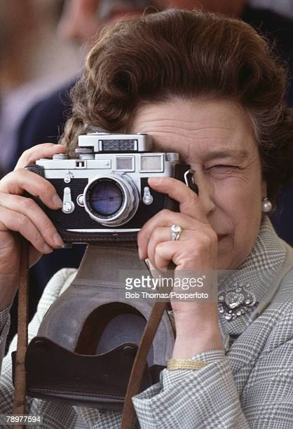 British Royalty Windsor England May 1982 Queen Elizabeth II holding a Leica camera about to take a photograph while attending the Royal Windsor Horse...